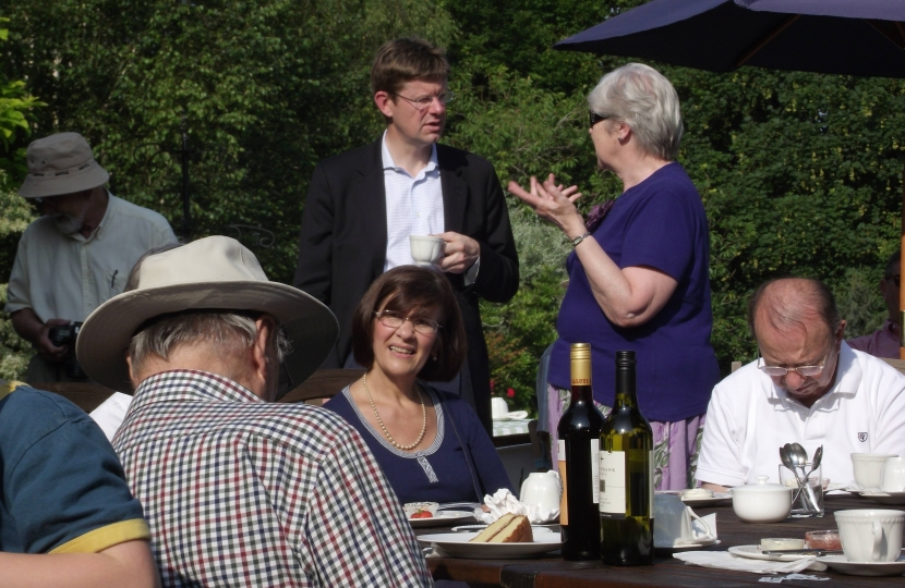 Greg Clark discussing issues with local residents