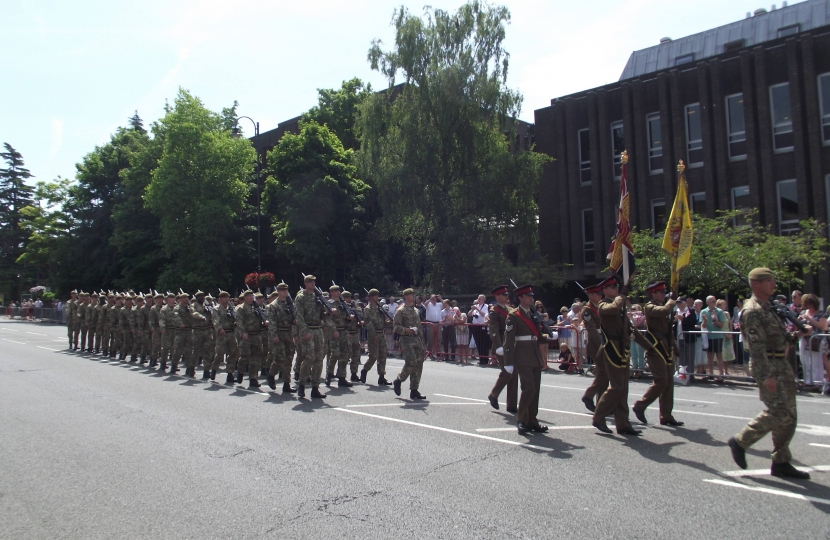 Troops march in from of the Assembly Hall